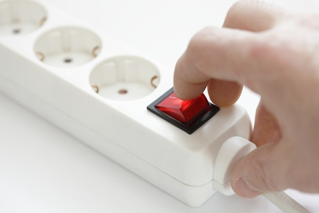 switch off the red circuit breaker with finger Stock Photo