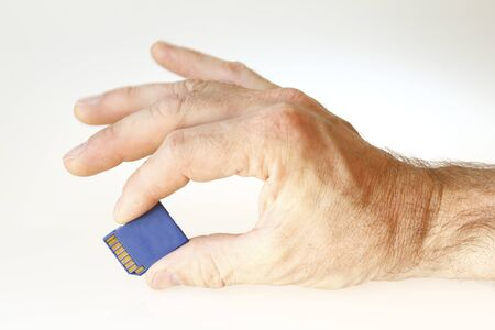 hand with memory card on withe background photo