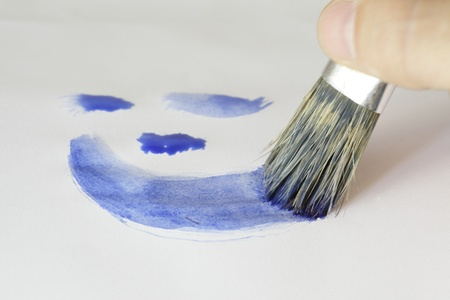 brush is painting blue lines on paper photo