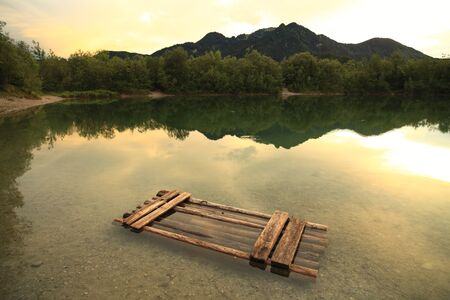 raft in lake with mountains in the background Stock Photo - 9991199