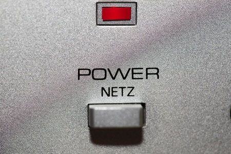 Silver power button with icon on-off and red led Stock Photo - 9991221