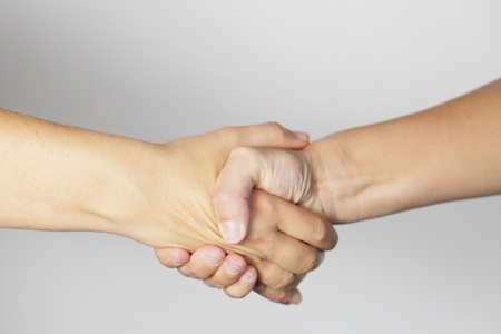Shaking hands of two people, on white background Stock Photo - 10111214