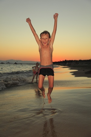 a Boy is jumping at the beach