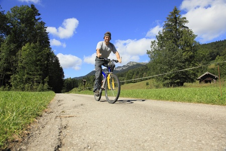 Mountain Biker on street and blue sky background Stock Photo - 10535843