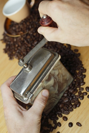 old Coffee grinder with brown coffee beans photo