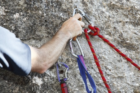rapell: Carbine and hook with rope in stone