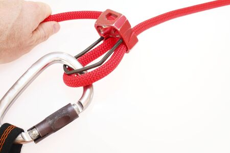 rapelling: Carbine and hook with rope for safety