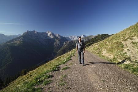 a hiker is walking in the austrian alps  Stock Photo - 10834659