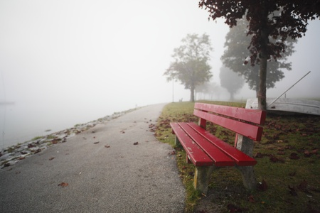 a way with a red bench with dust in background Stock Photo