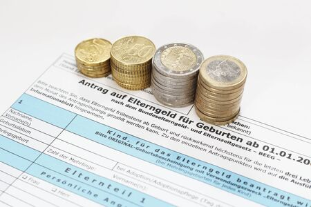 Application form with stack of some coins Stock Photo