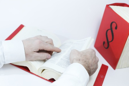 seeking in law book with hands, books in background
