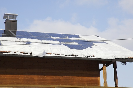 snow in winter on a photovoltaic roof