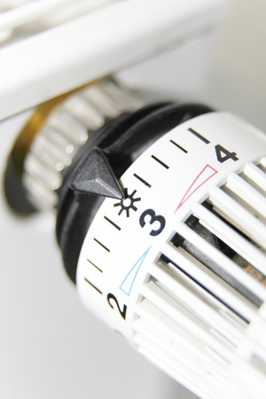 adjusting screw: close up of a thermostat on a radiator