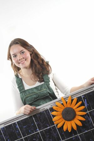 solarpower: Young woman with a solar panel,photovoltaic
