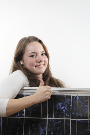 Young woman with a solar panel,photovoltaic Stock Photo - 11074459