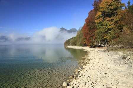 Autumn view to lake with mountains in background Stock Photo - 11074471