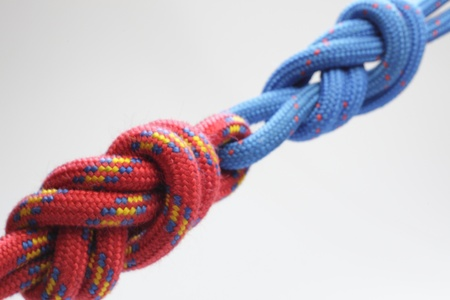 red rope with a double knot on white background