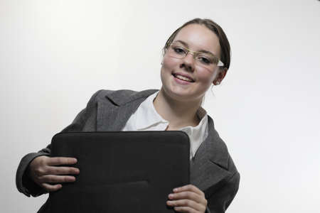 Young female student with notebook and white background Stock Photo - 11074473