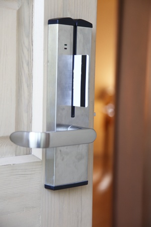 inserting keycard in the electronic lock. door. Stock Photo - 11074477