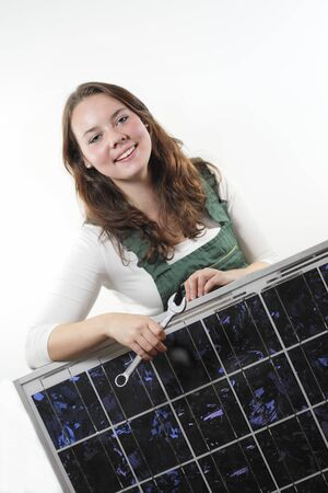 solarpower: female worker with photovoltaic module and wrench Stock Photo