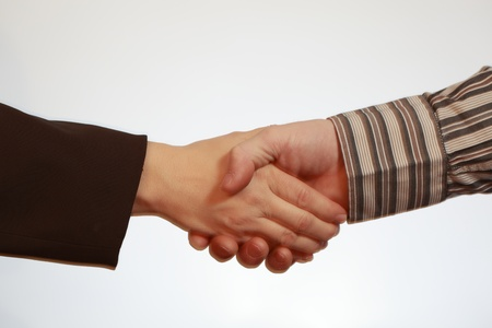 Hand shake between a businessman and a businesswoman Stock Photo - 11154702