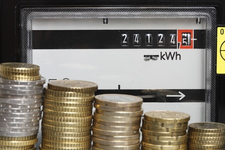Energy costs lots of money with coin stack