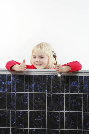 solarenergy: girl with solar panel and wrench is smiling Stock Photo