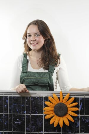 solarcell: female worker with photovoltaic module on white background Stock Photo
