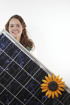 solarpower: teenager with photovoltaic module on white background