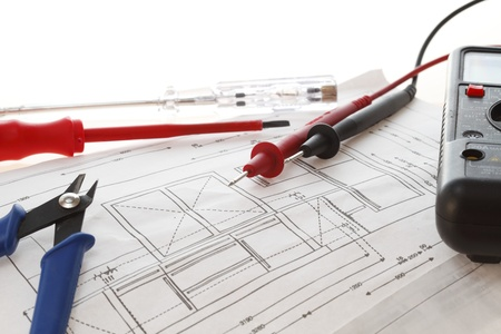 Electrical Equipment On House Plan with white background photo