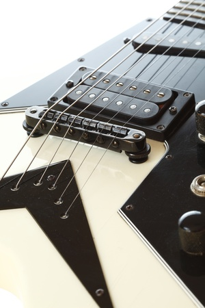 part of an electric guitar with pickup and strings photo