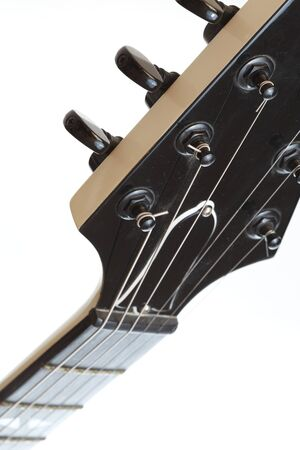 frets: View of the top of a black electric guitar with copy-space