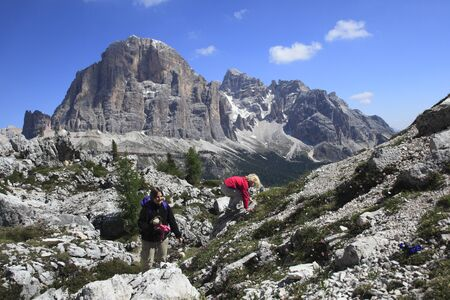 Young family hiking in the Dolomite Alps