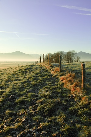 beautiful autumn morning landscape with mountains in background photo