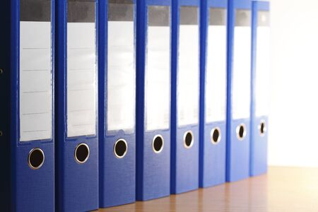 many blue file folders in office cabinet Stock Photo