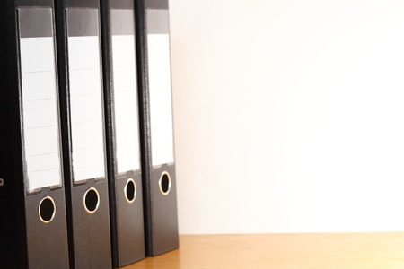 binders: office desk with a lot of file  folders  on a white background