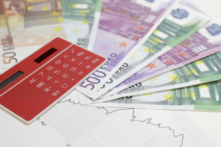 investment chart with red  calculator and money Stock Photo - 12100464