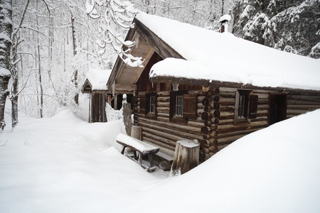 Refuge in the Alps.Wooden huts in the snow photo