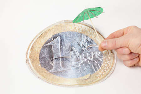 Financial crisis concept: save  euro coin with umbrella photo