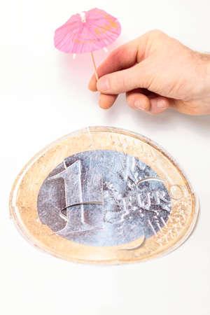 Financial crisis concept: save  euro coin with umbrella Stock Photo - 12338425