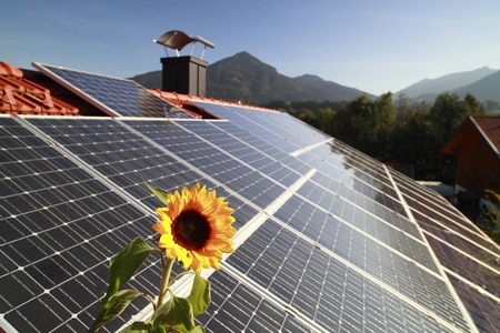 Photovoltaic panels on roof top with mountains in background