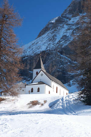 Snowy Landscape of Dolomites Mountains during Winter Season, Italy photo