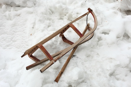 antique sleigh: a broken sledge is on the snow Stock Photo