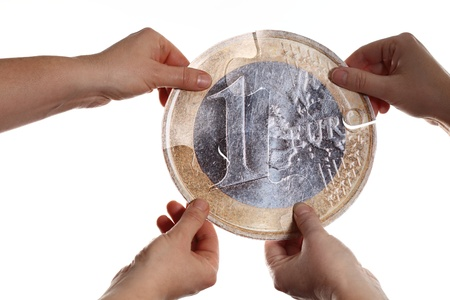 holding a big euro coin in hands photo