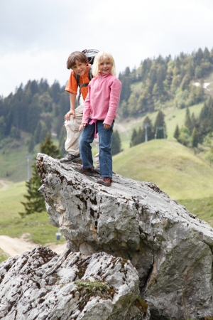 two kids are climbing  photo