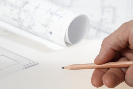 showing with pencil to plan in background Stock Photo