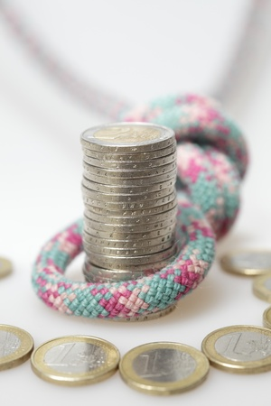 money stack with euro coins and safety rope Stock Photo - 14410232