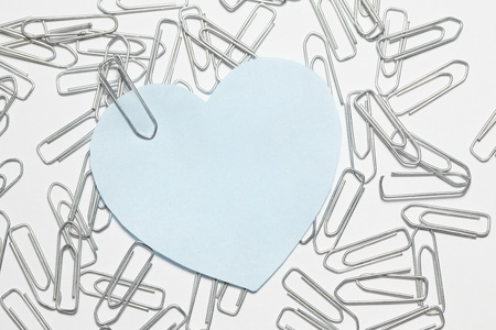 blue heart sticker with many paper clips photo