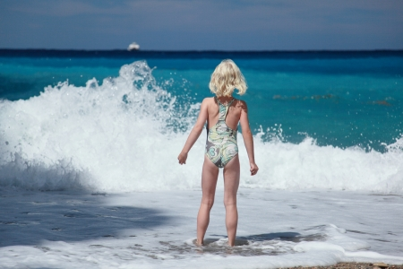 girl is looking to the beautiful big waves photo