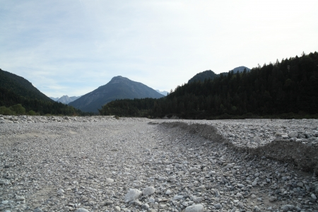 a field of gravel in the european alps photo
